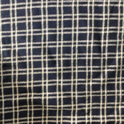 black and beige plaid fabric