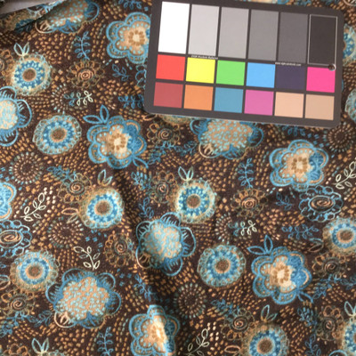blue and brown floral sheer knit fabric
