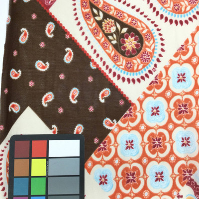 orange brown paisley floral mesh fabric