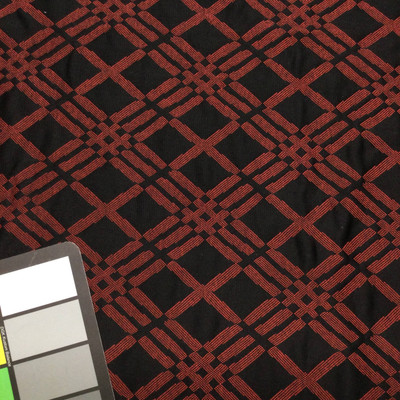 black and red diamond quilted fabric