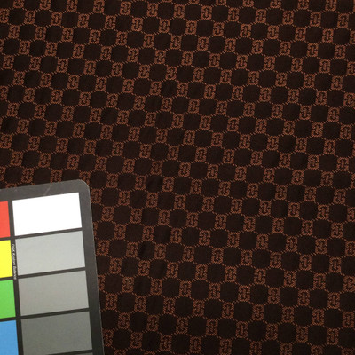 brown orange geometric quilted fabric