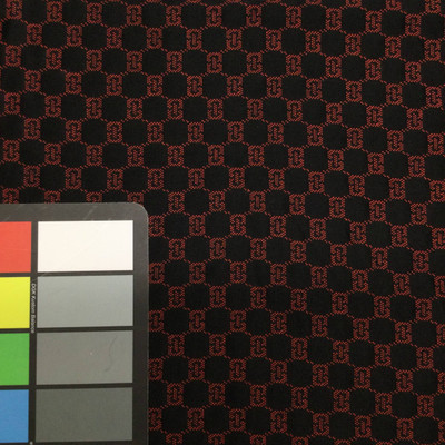black and red geometric quilted fabric