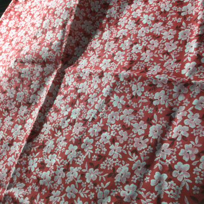 red pink floral print lightweight woven fabric