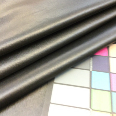 """Ebony Felt-Backed Faux Leather Vinyl Fabric 