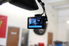 """The BlackVue DR750LW-2CH 1080p Full HD dual lens dash cam with 4"""" LCD touchscreen showing live view from front and rear cameras"""