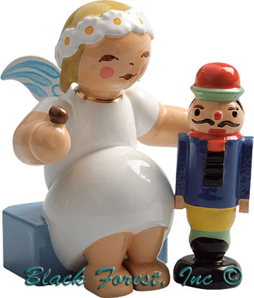 634-70-32 Wendt and Kuhn Marguerite Angel Sitting with Nutcracker and Nut
