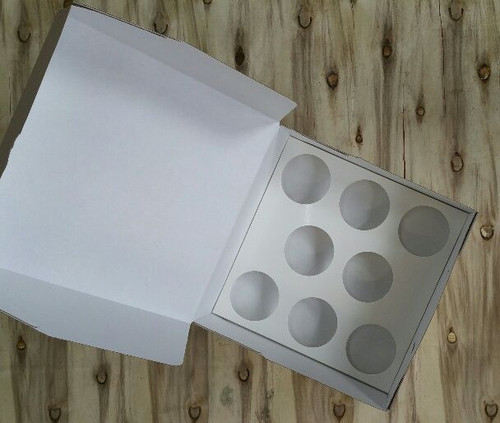Cupcake insert holds 9 cupcakes in a 10 inch cake box (not 8 as in picture)