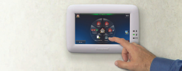 """Honeywell's vibrant Graphic Touchscreen lets you control your facility's security system with ease— with vivid, intuitive icons guiding you and your employees every step of the way. You'll find that the brilliant, 7"""" display can also serve as a dynamic communications tool for your business. No other keypad can touch it!"""