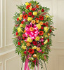 Crafted from fresh and brightly colored blooms, our heartfelt standing spray is a beautiful symbol of your love and support. Gathered with roses, lilies, Gerbera daisies, mums, snapdragons, alstroemeria, carnations and more, let it convey your deepest sympathies and let them know they're in your thoughts.