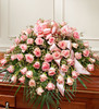 "•Features gorgeous long stem pink roses, waxflower and vibrant greenery •Traditionally sent by the immediate family to the funeral home •Our florists use only the freshest flowers available, so colors and varieties may vary •Arrangement measures approximately 16""H x 28""W x 36""L"