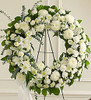 """•Standing wreath arrangement of fresh white flowers such as roses, football mums, carnations and more •Accented by spiral eucalyptus, salal and more •Appropriate for family, friends and business associates to send directly to the funeral home •Our florists use only the freshest flowers available, so colors and assortment may vary •Large measures approximately 34""""H x 34""""L without easel •Small measures approximately 32""""H x 32""""L without easel •Easel may not be available in all areas"""