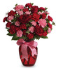 Show them how much you care with a sweet mix of roses and carnations in shades of pink and red.