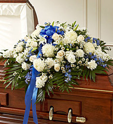 When someone this close and special passes, it's important to celebrate all the love, care and devotion you feel for them. This half casket cover, crafted with painstaking care and artistry by our expert florists, features long stem white roses, blue delphinium and more to create an unforgettable final tribute to a life well lived.