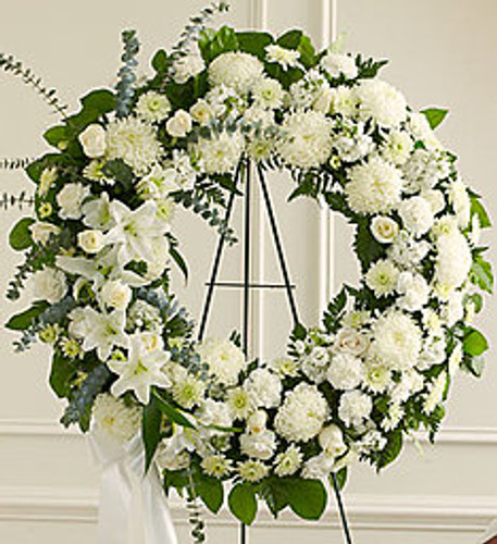 "•Standing wreath arrangement of fresh white flowers such as roses, football mums, carnations and more •Accented by spiral eucalyptus, salal and more •Appropriate for family, friends and business associates to send directly to the funeral home •Our florists use only the freshest flowers available, so colors and assortment may vary •Large measures approximately 34""H x 34""L without easel •Small measures approximately 32""H x 32""L without easel •Easel may not be available in all areas"