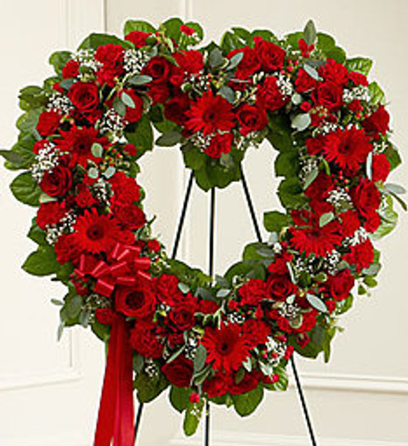 •Heart-shaped arrangement of fresh red roses, gerbera daisies, carnations and more •Accented by baby's breath, salal, seeded eucalyptus and more •Comes on a wire easel with accents and satin ribbon •Appropriate for family and friends to send directly to the funeral home
