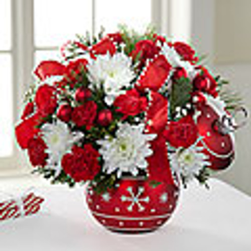 A ceramic ornament style vase (comes with lid) makes the perfect setting for this exuberance of red roses (in Deluxe, Premium and Exquisite versions only) and carnations, white cushion pompons and million star gypsophila accented with glass balls, Christmas greens and fancy holiday ribbon.