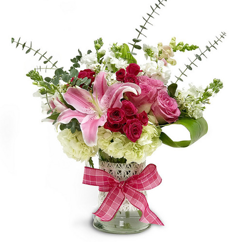 Add some style this Valentine's Day with this show-stopping design featuring beautiful pink roses, wonderful white hydrangea and an enchanting Stargazer lily. Hand-delivered in a tall glass vase with accent greens and eucalyptus, and wrapped with a pretty pink bow, this red-carpet worthy design is sure to delight your favorite diva!