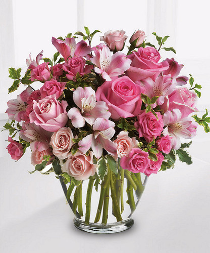 Send Mom this lovely and utterly feminine tribute of soft pinks featuring roses and alstroemeria.