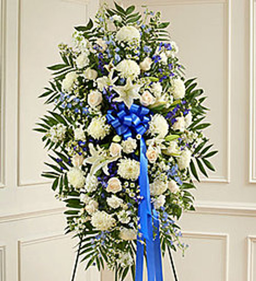 DEEPEST SYMPATHIES BLUE AND WHITE STANDING SPRAY Show all the love and compassion you have in your heart during times of loss with our beautiful blue and white standing spray. Gathered fresh with blue and white blooms, this expertly crafted arrangement is a tasteful and touching expression of your care and concern.