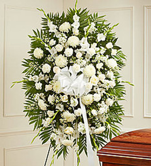 White flowers are often sought after as symbols of honor, reverence and remembrance. This striking standing spray—exquisitely crafted by our expert florists from an assortment of pure white blooms—is the perfect expression of all the love, compassion and support you feel during their time of mourning.