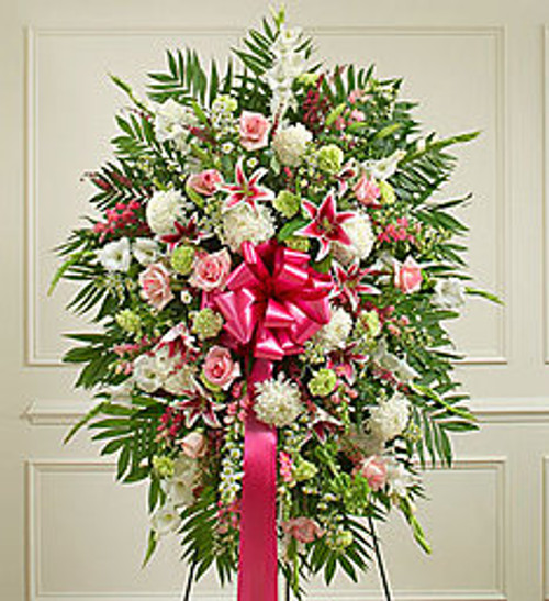 Convey your deepest sympathies and continued support with this vibrant standing spray. Expertly crafted by our local florists from an assortment of pastel blooms, it's a comforting way to let them know you're thinking of them during a difficult time.
