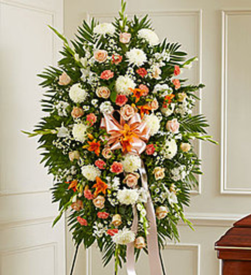 "•Peach roses, orange Asiatic lilies, white carnations and more •An appropriate gift for family, friends and business associates to send directly to the funeral home •Our florists use only the freshest flowers available so colors and varieties may vary •Large measures approximately 52""H x 42""L without easel •Medium measures approximately 46""H x 38""L without easel •Small measures approximately 42""H x 30""L without easel"