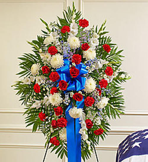 Honor a beloved veteran for their dedicated service with this heartfelt patriotic arrangement. Meticulously crafted by our expert florists using the freshest red, white and blue blooms, it perfectly conveys all the love, pride and sympathy you feel in your heart.