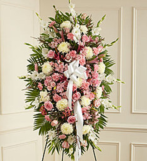 """•Pink roses, stargazer lilies, spray roses, white carnations and more •An appropriate gift for family, friends and business associates to send directly to the funeral home •Our florists use only the freshest flowers available so colors and varieties may vary •Large measures approximately 54""""H x 42""""L without easel •Medium measures approximately 46""""H x 38""""L without easel •Small measures approximately 42""""H x 32""""L without easel"""