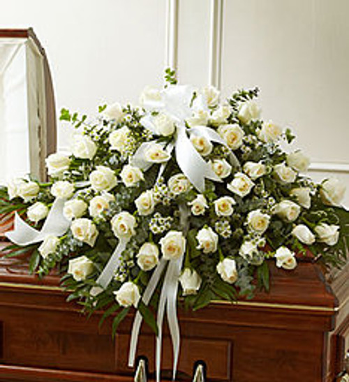 Every moment spent with your loved one is a memory you want to hold onto forever. Commemorate their life, and all the feelings you have for them, with this beautiful white casket cover, crafted by our expert florists with long stem white roses, for a fitting final tribute.