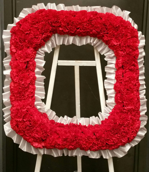"""This Ohio State """"O"""" is created by hand on a styrofoam frame with red carnations attached to the frame and  trimmed in gray ribbon.  This """"O"""" will then be anchored and displayed on an easel for viewing. (LOCAL DELIVERY ONLY)"""