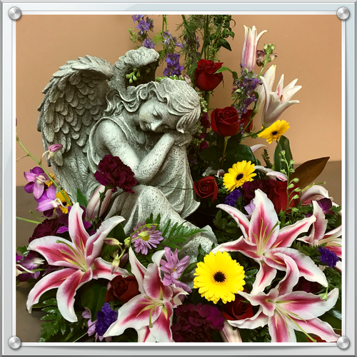 This arrangement, as shown, contains yellow gerber daisies, stargazer lilies, larkspur, red roses, burgundy carnation, dendrobium, lavender daisies, status and assorted greens for $250.  Prices start at $199.99 and can be custom made with flowers other than what is shown.