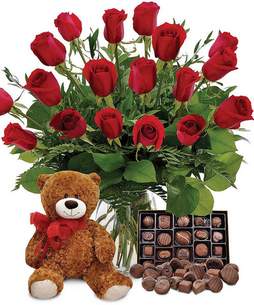 Show your love with this ultimate combo of roses in the color of your choice, delicious chocolates, a romantic mylar balloon and a cuddly teddy bear!  Vase and/or teddy bear may vary.