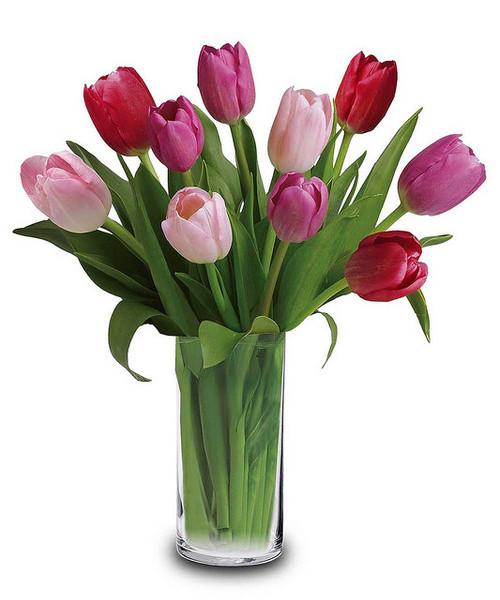 Ten romantic tulips in shades of pink arranged in a clear glass vase.