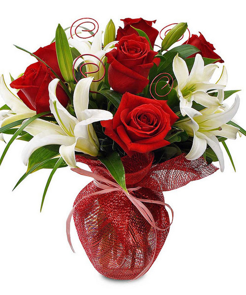 A collection of favorite flowers for your sweetheart. Wrapped in red mesh and pink raffia, oriental lilies and red roses stand out. Red wire accents complete the arrangement. Inspire your loved one with this romantic arrangement.