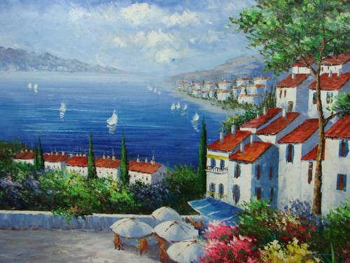 Beautiful painting, stretched but without frame, by Damini.  Large white villas, surrounded by green shrubs and flowers, line the shore of a blue sea filled with sailboats.