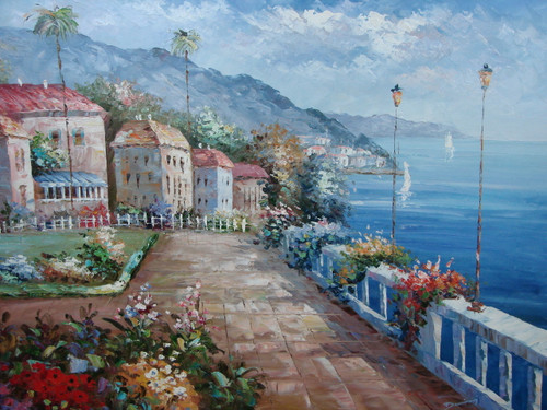 Beautiful, large painting, stretched but without frame, by Damini.  Pink, yellow and blue flowers grow along a path with a white fence near a seaside village.