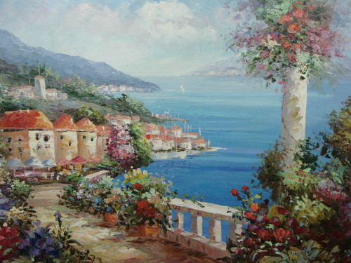 Beautiful, large painting, stretched but without frame, by Damini.  Beige villas line the seashore with pink, red, blue and yellow flowers planted along a narrow path that overlooks calm blue water.
