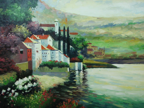 Beautiful, large painting, stretched but without frame.  Green and purple leafed trees grown on a hillside behind white villas that face reflective waters.