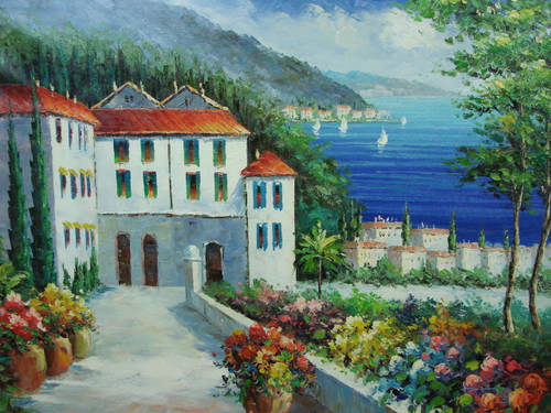 Beautiful large sized painting, stretched but without frame, by Damini.  Large white villas with tile roofs sit at the base of green hills with colorful flowers, overlooking bright blue water.