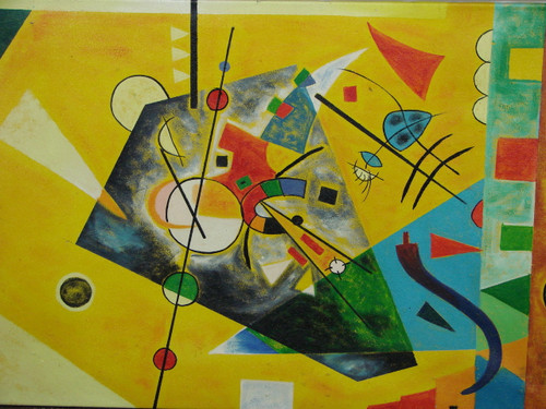 Modern / abstract oil painting, stretched canvas but without frame, signed by Legrand.  Geometric shapes of yellow, red, orange, blue and green are mixed together in this medium sized painting.