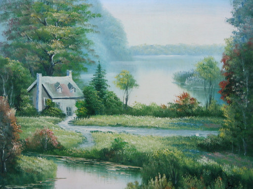 Beautiful small painting on canvas, stretched but without frame, signed by Joy.  Surrounded by blue-grey water, a Thomas Kinkade inspired cottage sits on an island of green grass and full green trees.