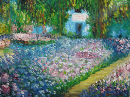 Beautiful painting on canvas, stretched but without frame, signed by Sandra Lepine.  Light blue, purple and pink flowers fill the lawn in front of a grey home hidden away by bright green trees.