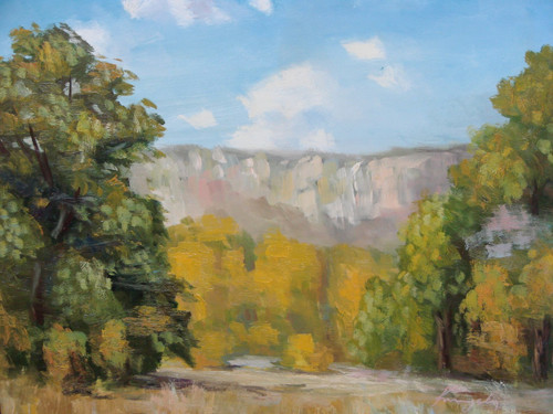 Beautiful painting on canvas, stretched but without frame, signed by Kingsley.  Trees with green and golden yellow leaves grow at the foot of a grey mountain range.