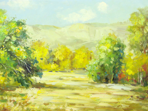 Beautiful medium sized painting, stretched but without frame, signed by Paul Seward.  Golden yellow and green trees grow in sandy colored ground at the base of tan mountains.