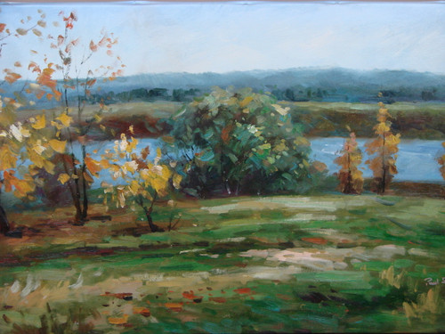 Beautiful medium sized painting, stretched but without frame, by Paul Seward.  Yellow and green colored trees grow on the grassy bank of a blue river.