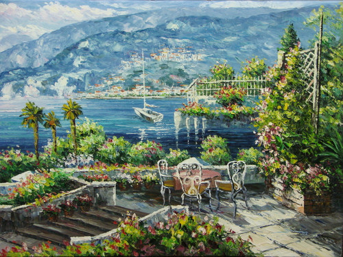 Beautiful medium sized painting, stretched but without frame, by Damini.  Pink flowers bloom on green hedges surrounding a veranda with a small table overlooking the dark blue water filled with sailboats below.