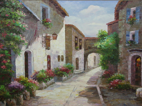 Beautiful medium sized painting, stretched but without frame, by Jaster.  A stone street runs between beige villas surrounded by flowering green shrubs and plants.