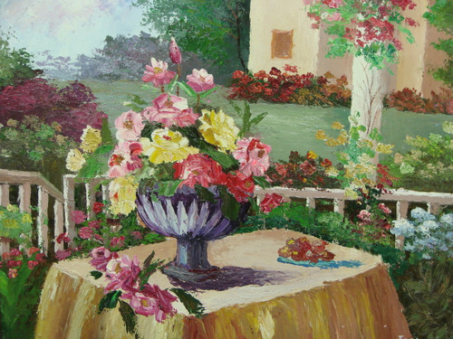 Beautiful medium sized painting, stretched but without frame, by Jaster.  A vase full of yellow and pink flowers sit on a table in garden of colorful flowering bushes.