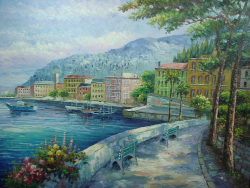 Beautiful large painting, stretched but without frame, by Damini.  Light green, yellow and red buildings line the seashore surrounded by green trees and a stone walking path.