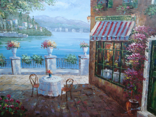 Beautiful large painting, stretched but without frame, by Damini.  A table is set outside a bistro overlooking the blue sea and hillside of villas in the background.